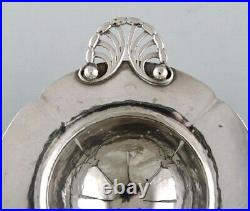 Early and rare art nouveau Georg Jensen tea strainer in silver with ebony handle
