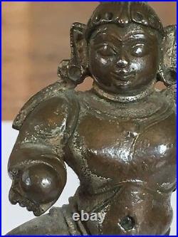 Rare, beautiful, early Indian silvered bronze Bale Krishna, 14 century