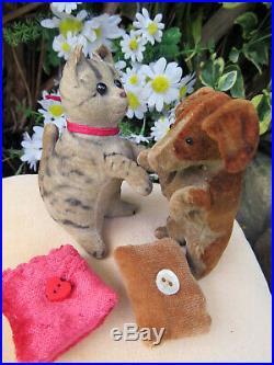 Rare early velvet Steiff begging dog with button